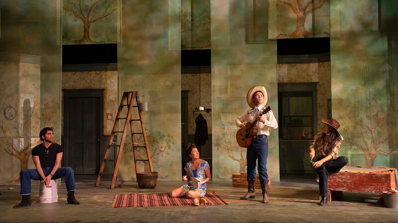 The cast. Set design by Marshall McMahen, costume design by Barbara Clayden, and lighting design by Sophie Tang. Photo by David Cooper.