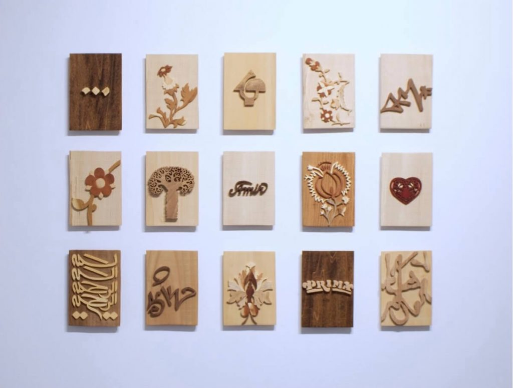 """Soheila Esfahani, Made in Iran, detail, Various types of wood, 4.5"""" x 6.5"""" each plaque, 2010."""